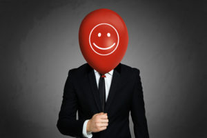 A person faking a happy face
